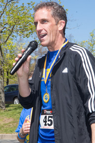 Lane Glenn gives a speech after a run, for which he was awarded a medal.