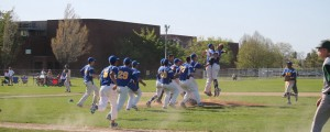 NECC's baseball team, the Knights, jump and hug each other after a victory on the baseball diamond.