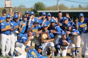 NECC baseball players pose with trophy