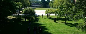 Wide shot of various NECC students taking pictures on campus.