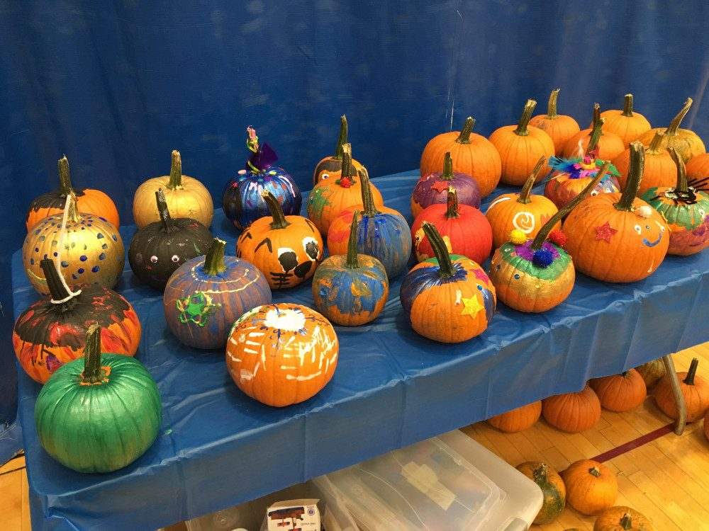 a table displaying decorated pumpkins