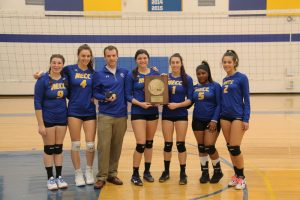 Photo of women's volleyball team standing together holding award