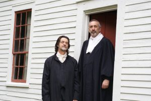 two men dressed in colonial outfits