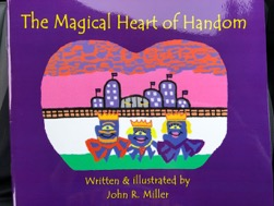 Picture of John miller's book. It has a purple cover and an illustration in the center